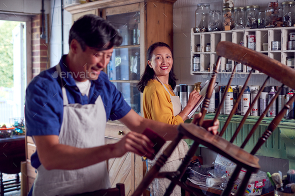 Mature Asian Couple Restoring Furniture In Workshop At Home Together - Stock Photo - Images