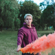 Street style man in hoodie hold hand flare with red smoke grenade bomb. - PhotoDune Item for Sale