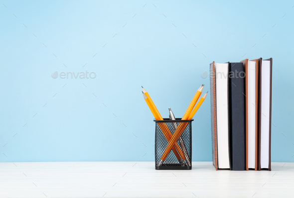 Studio workspace with notepads and office supplies - Stock Photo - Images
