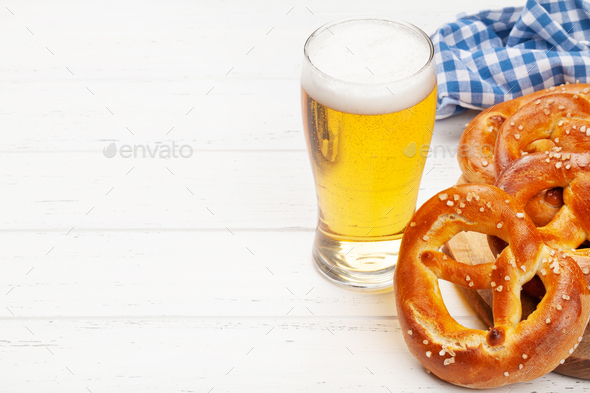 Lager beer mug and fresh baked homemade pretzel - Stock Photo - Images