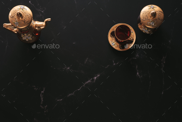 Flat lay of Luxurious tea equipment in red and gold - Stock Photo - Images