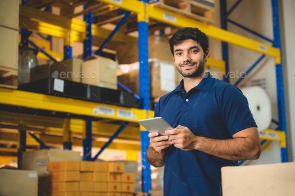 Male warehouse worker portrait in warehouse storage - Stock Photo - Images