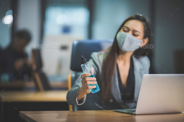 business women using spray alcohol to cleaning hand - Stock Photo - Images