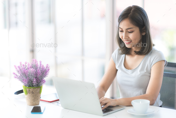 Asian young women using labtop for working at home, living and work at home - Stock Photo - Images