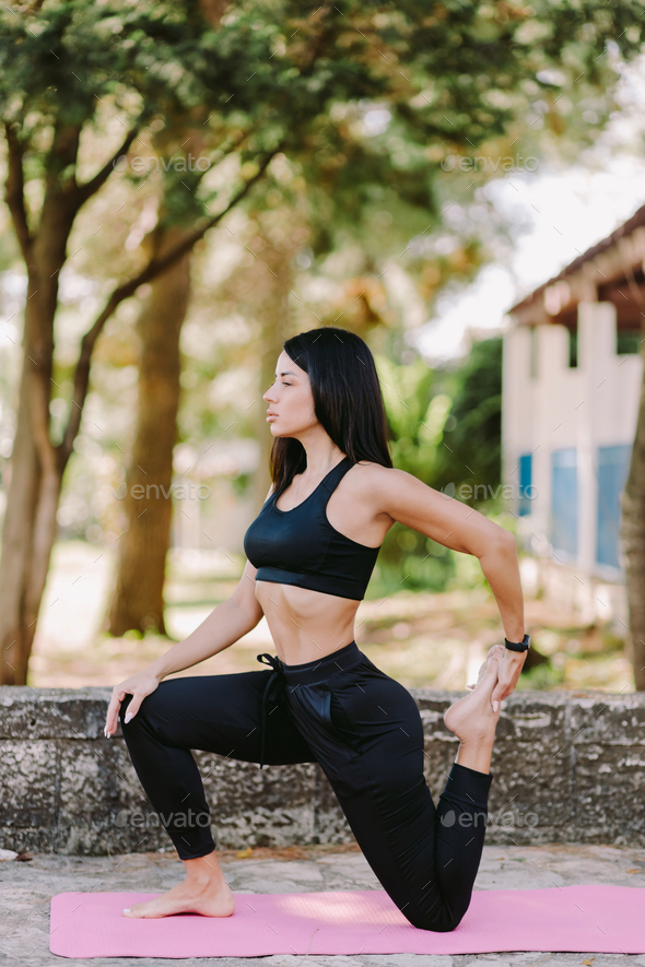 young woman meditation yoga practice morning routine outdoors in park - Stock Photo - Images