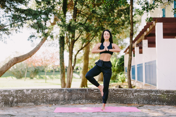 young attractive woman meditation yoga namaste gesture practice - Stock Photo - Images