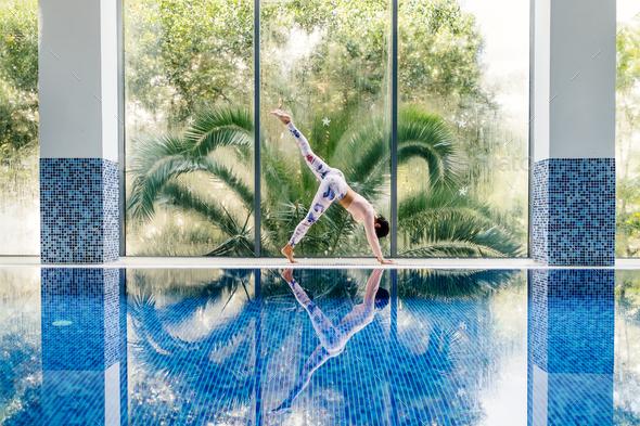 beautiful sporty woman yoga asana practice morning routine - Stock Photo - Images