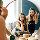 Two beautiful teenage girls look at their reflection in the mirror. Young narcissistic women. - PhotoDune Item for Sale