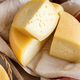Pieces of  fresh homemade cheese on a tray close up - PhotoDune Item for Sale