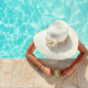 Young woman in a straw hat with tropical cocktail in a pool - PhotoDune Item for Sale