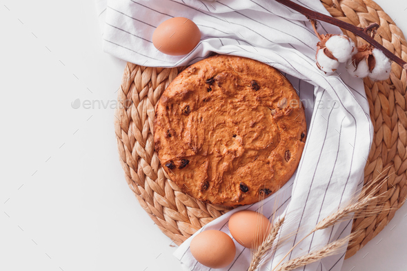 Easter cake and eggs on wicker cloth. Top view copy space. Isolated on white - Stock Photo - Images