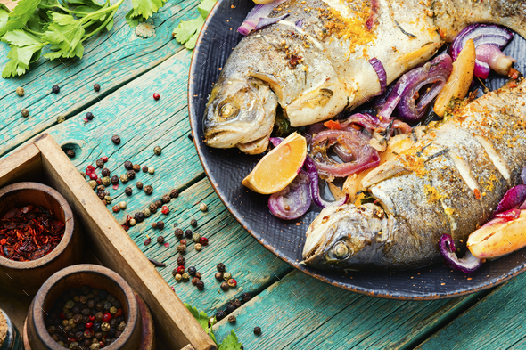 Baked trout with lemon,grilled trout - Stock Photo - Images