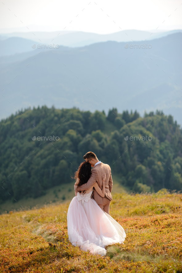 Young love couple celebrating a wedding in the mountains - Stock Photo - Images