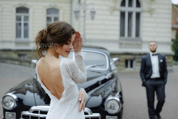 Beautiful retro couple against vintage car - Stock Photo - Images
