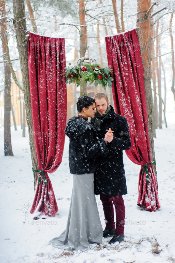 Wedding ceremony for two near the red arch - Stock Photo - Images