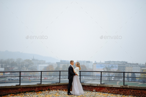 Two lovers walk along Krakow - Stock Photo - Images