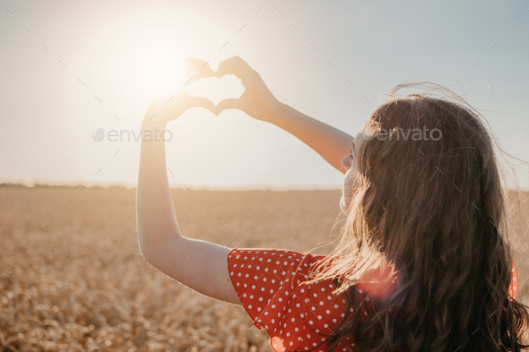 Vitamin D in Womens Health, Role of Vitamin D3 Supplements in female health. Young woman enjoying - Stock Photo - Images