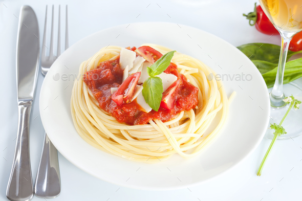 Spaghetti with tomato sauce and parmesan - Stock Photo - Images