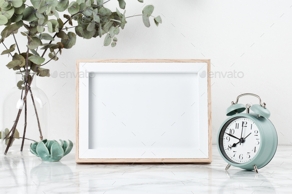 Poster frame mockup, front view, with decor elements, flowers and blank copy space over the white - Stock Photo - Images