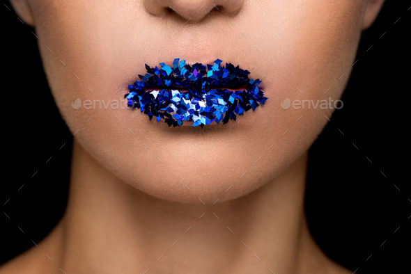 cropped view of fashionable woman with blue sparkles on lips, isolated on black - Stock Photo - Images