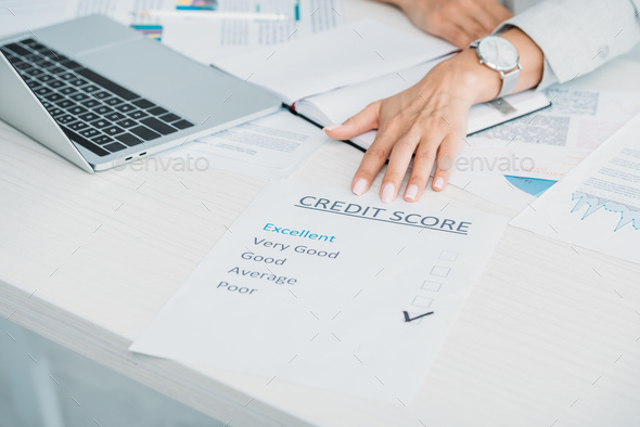 cropped view of woman showing credit score at office - Stock Photo - Images