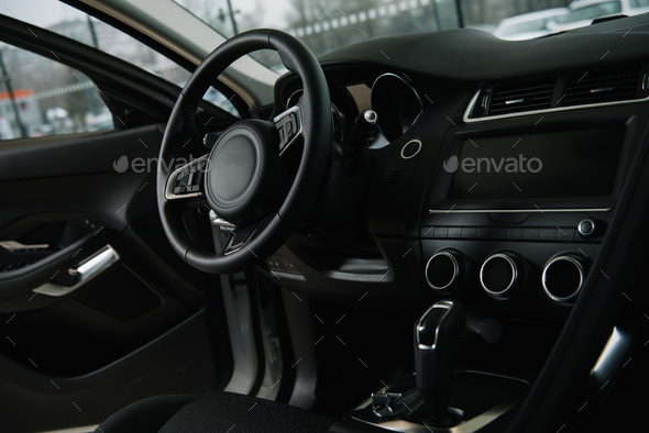 black steering wheel near manual transmission in luxury car - Stock Photo - Images