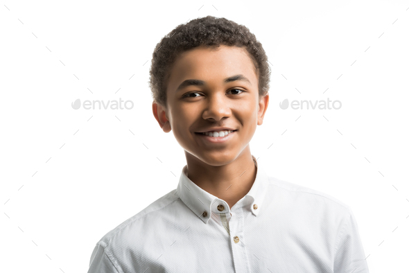 portrait of smiling african american teenager in white shirt looking at camera isolated on white - Stock Photo - Images