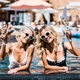 blonde smiling women in sunglasses relaxing in swimming pool with champagne glasses - PhotoDune Item for Sale