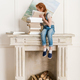 little girl reading book while sitting on fireplace - PhotoDune Item for Sale