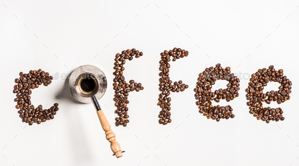 Top view of word coffee made from coffee beans and turkish coffee pot - Stock Photo - Images