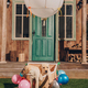 cute labrador puppies sitting in box of air balloon near house - PhotoDune Item for Sale