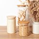 Assortment of grains, cereals and pasta in glass jars on wooden table. Zero waste kitchen storage - PhotoDune Item for Sale