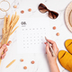 Flat lay with calendar for August with summer holidays fashion accessories - PhotoDune Item for Sale