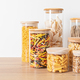 Assortment of italian traditional pasta in glass jars on wooden table. Zero waste kitchen storage - PhotoDune Item for Sale