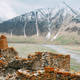 Fortress On Mountain Background Near Karatkau Village, Kazbegi District, Mtskheta-Mtianeti Region - PhotoDune Item for Sale