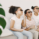 Kids watching a movie on couch in 3d glasses with popcorn - PhotoDune Item for Sale