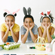 Happy kids posing for a photo in rabbit ears - PhotoDune Item for Sale