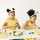 Children in yellow clothes paint Easter eggs - PhotoDune Item for Sale