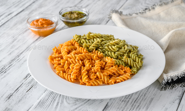 Fusilli with traditional and tomato pesto - Stock Photo - Images