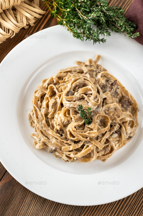 Tagliatelle with porcini mushrooms - Stock Photo - Images