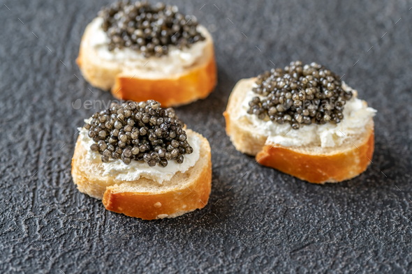Canape with black caviar - Stock Photo - Images
