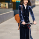 Young business woman wearing blue suit using electric scooter - PhotoDune Item for Sale
