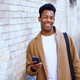 Young black man using his smartphone outdoors - PhotoDune Item for Sale