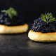 Crackers with black caviar - PhotoDune Item for Sale