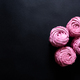 Homemade pink marshmallow on a black background. Top view - PhotoDune Item for Sale