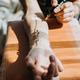 Tattoo design, creative artist working process. Close-up hand of tattoo master with tattoo machine - PhotoDune Item for Sale