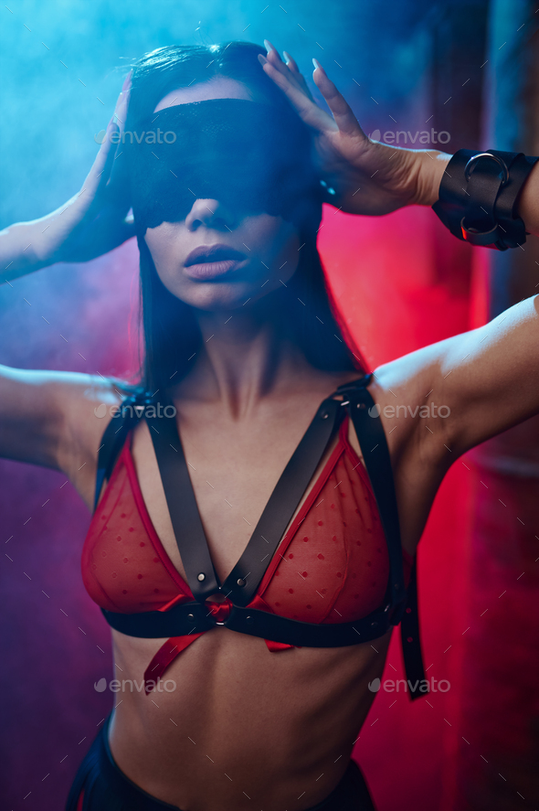 Sexy woman poses in bdsm blindfold and handcuffs - Stock Photo - Images