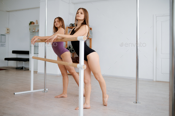 Women gymnasts on pole dance training in class - Stock Photo - Images