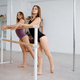 Women gymnasts on pole dance training in class - PhotoDune Item for Sale