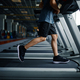 Youngster doing exercise on treadmill in gym - PhotoDune Item for Sale
